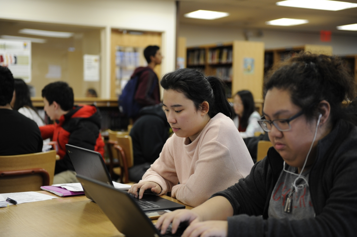 Ashley Loke 18' works hard in the library to finish off her college applications.