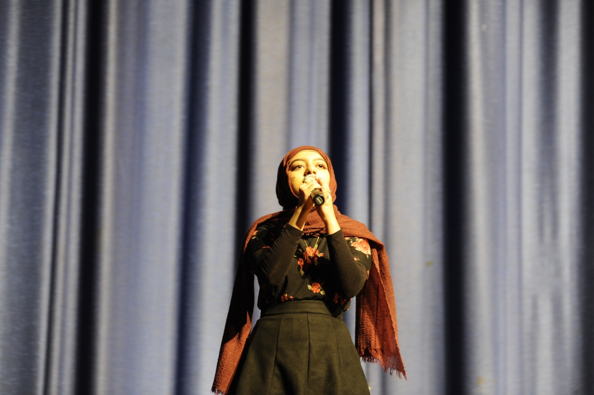 "Naima Nadia '19 singing ""Young Dumb & Broke"" during the S.O. Talent Show."