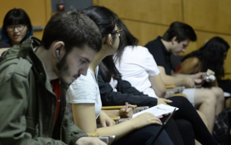 A student watches the Netflix series during his study hall period in the auditorium.