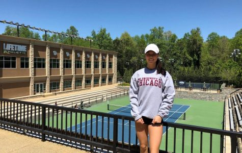 Perene Wang '19 posing in front of the University of Chicago Tennis Court. Courtesy of Perene Wang '19