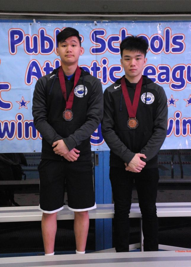 Jonathan Hu '19 and Andrew Chen '19 pose for a picture after earning fourth and seventh place respectively in springboard diving.