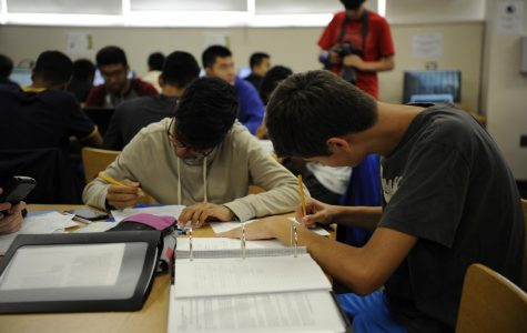 Students study together in the Bronx Science library, preparing for the SAT.