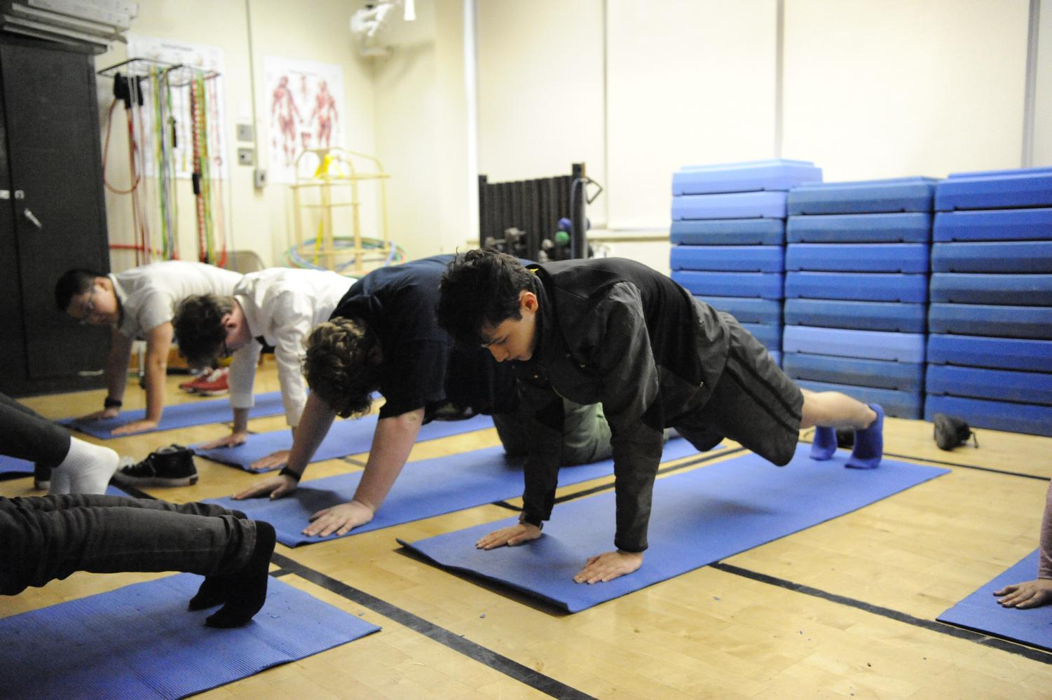 Bronx Science students enjoy a yoga class, one of many ways our school is working to reduce stress levels of our students.