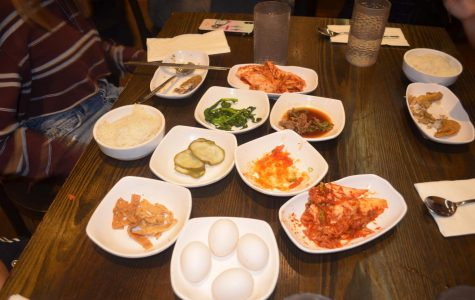 """""""The kimchi tofu soup consists of a raw egg, shrimps, mussels, tofu, red peppers, and beef. These simple toppings along with the steaming soup combine together to create a superb dish which exerts a spicy and savory flavor,""""said Cameron Chang '20."""