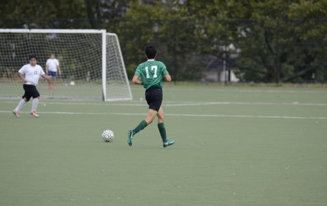 Dilan Minutello '19 kicks the ball during a Boys' Varsity Soccer game. Minutello has great things to say about the progress of the Puma company.