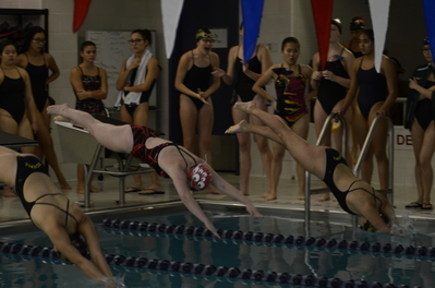 Katherine Zhou '20 and Margaux Reyl '21 dive in for their 200 free in a meet against LaGuardia High School.