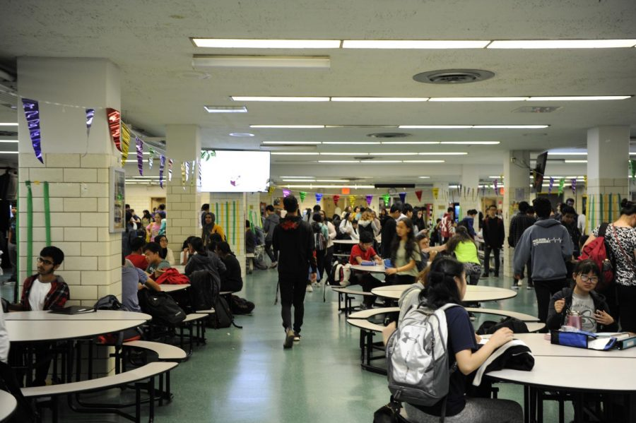 The cafeteria, the center of lunchtime, is full of students eating, socializing, and catching up on school work.