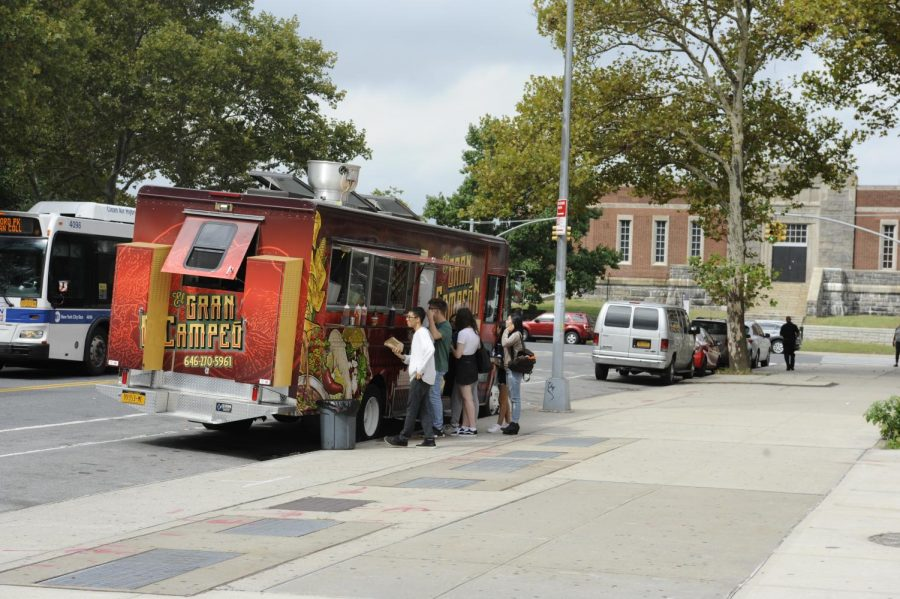 Students flock to the popular food trucks to buy lunch during their lunch period.