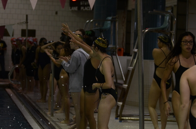 Olivia Chin '18 cheers for her fellow swimmers during a swim meet.