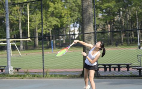 Cassie Tian '19 of the Girls' Varsity Tennis team serves a ball during a match at the Williamsbridge Oval Park.