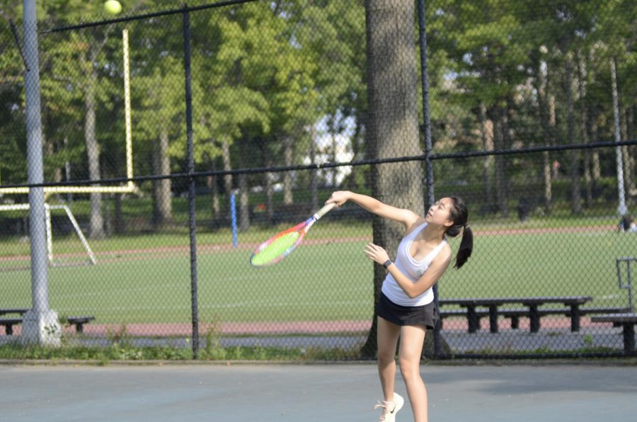 Cassie+Tian+%2719+of+the+Girls%27+Varsity+Tennis+team+serves+a+ball+during+a+match+at+the+Williamsbridge+Oval+Park.++