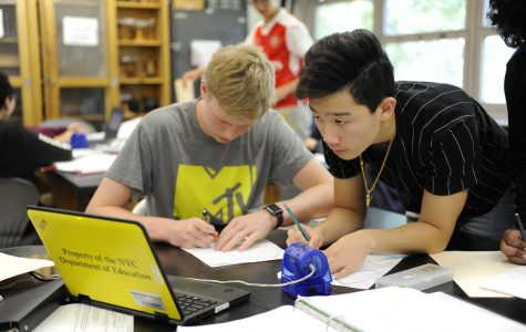 Kyle Catry '20 (left) works diligently with his partners on an A.P. Physics lab assignment, which will help to prepare him for both the Advanced Placement exam and the Regents exam in this subject area.