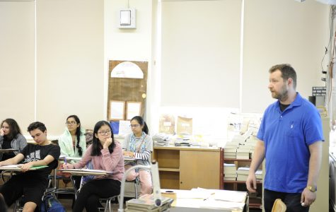 Mr. Grossman listens intently during a class discussion on George Orwell's '1984' in his sophomore English class.