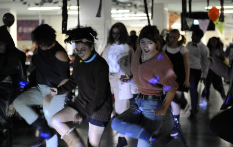 Students danced to music played by a professional D.J. in the cafeteria during Halloween festivities.