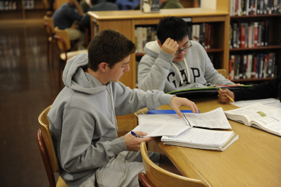 Joshua Kutler '21 (left) and Winson Chen '21 (right)  concentrate on their studies in the library.
