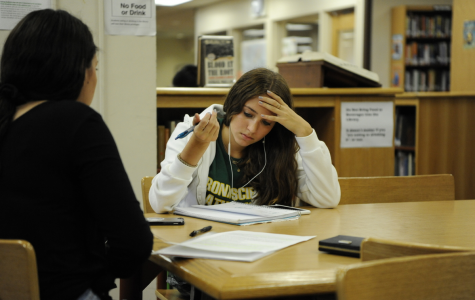 Ellie Selden '21 focuses intently on her work in the library.