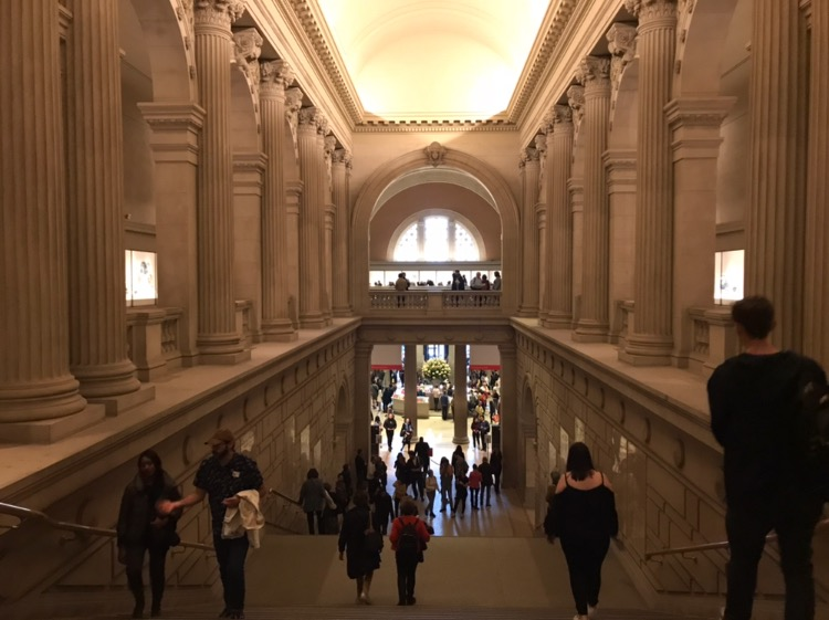 The MET's front hall, bustling with people on a Friday afternoon.