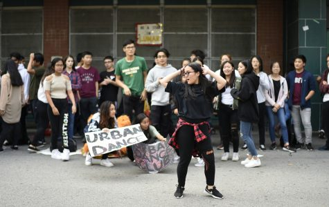 """Lin Zhang '19 breaks a move in the club fair. """"My nervousness overwhelmed me as I stepped into the center of the dance floor. I am thankful for everyone who supported me that day,"""" she said."""