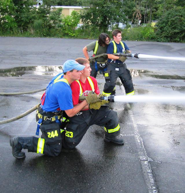 Christopher Dahlem (far left) working with the rest of his firefighting team during a training exercise. Such exercises are vital towards ensuring that firefighters are prepared to fight real fires.