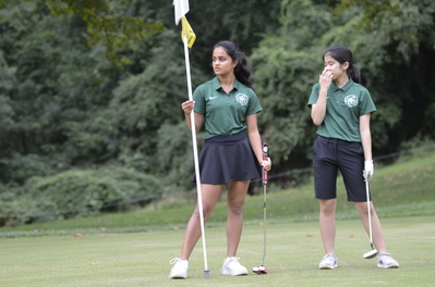 Girls Varsity Golf team at a match.
