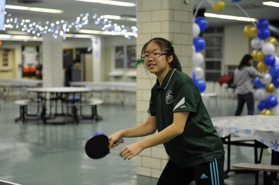 Jasmine Lo '21 practices using both sides of the paddles to improve her skills.
