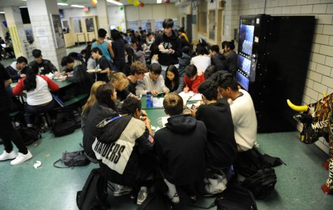 Located in the back of the cafeteria and marked by the characteristic verdant green color of its tables, the senior section of the student cafeteria is a popular social destination.