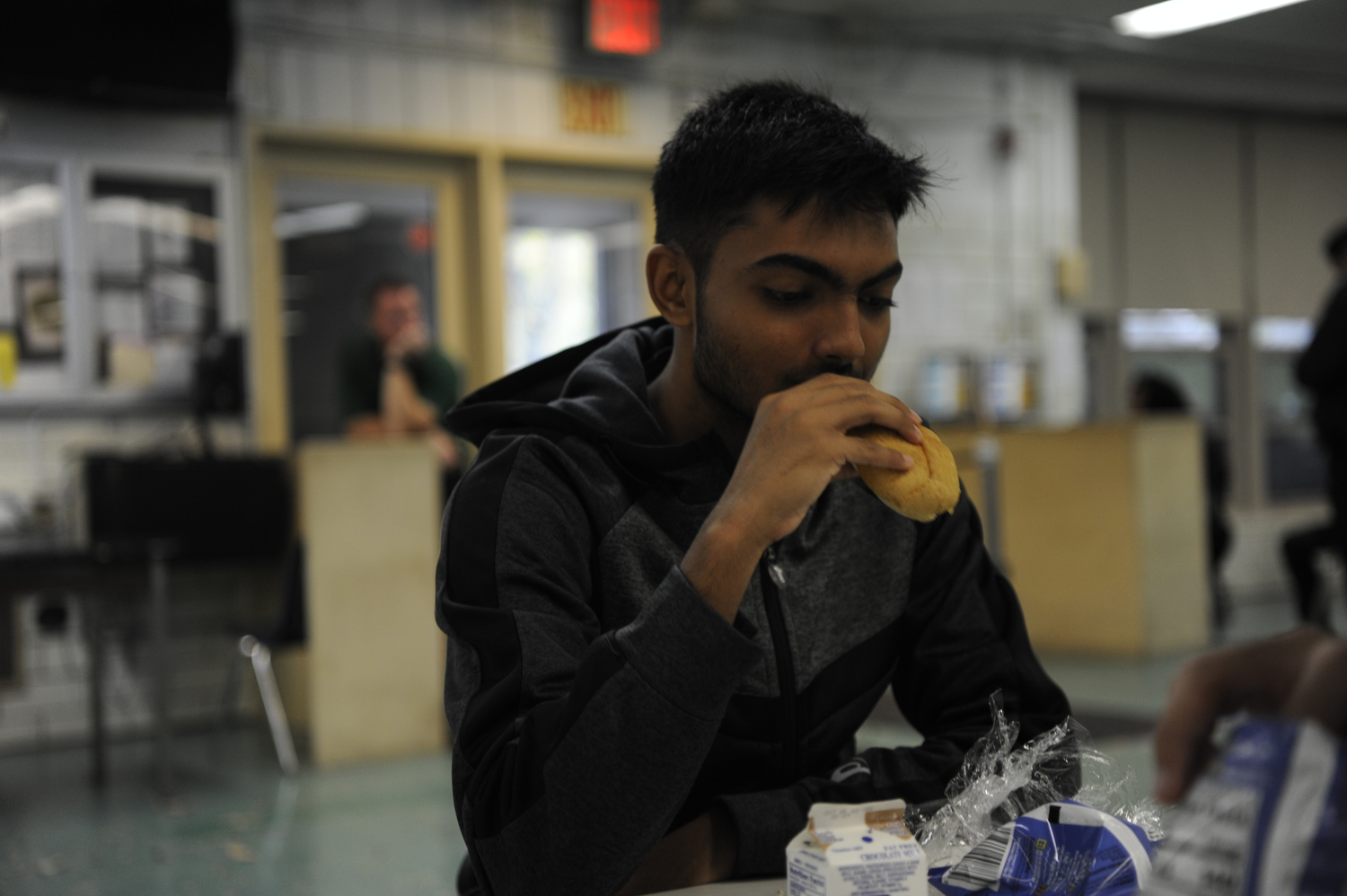 Rahil Ahmed '20 eating bread, the portion of his school lunch that does not have meat.
