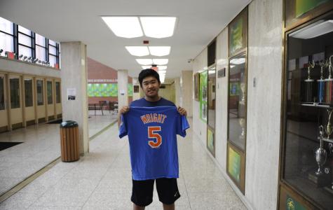Justin Chan '19 holds up a David Wright shirt.