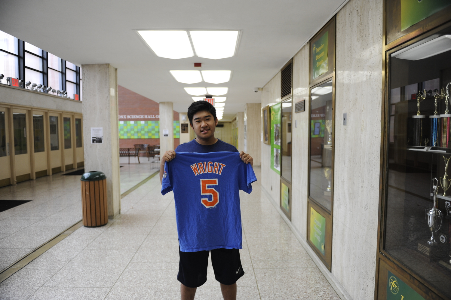 Justin Chan '19 holds up a David Wright shirt.