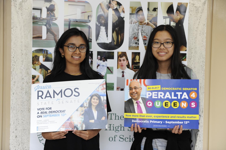 Tashfia Haidar '19 (left) & Joy Lin '19 (right) holding campaign posters of victorious insurgent Jessica Ramos & incumbent IDC member Jose Peralta