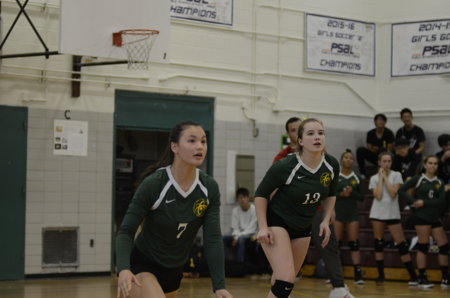 During a Girls' Varsity Volleyball game, both Grace Lorch '22 and Amanda Maeglin '20 concentrate intensely.