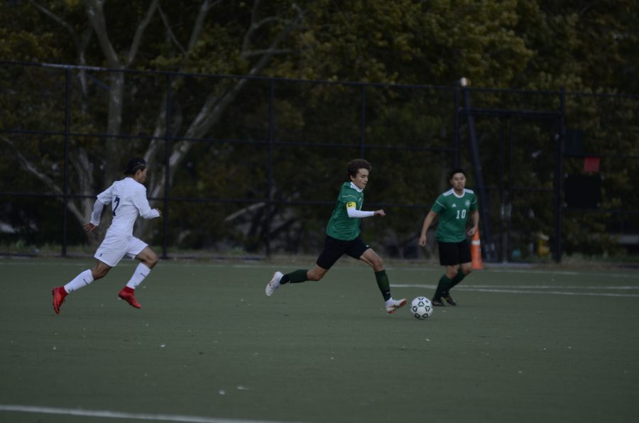 An agressive attack from the Boys' Varsity Soccer Team prevents their opponents from scoring a goal.