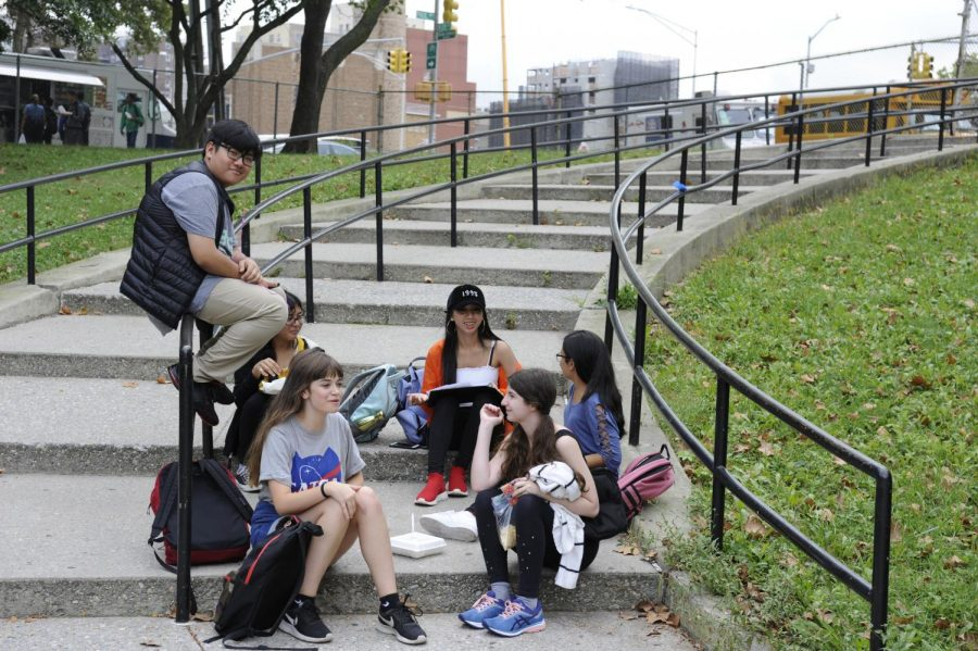 A group of Bronx Science students enjoy the warm fall weather. At Bronx Science, students are given some freedom in clothing choices, unlike as at some schools across the country.