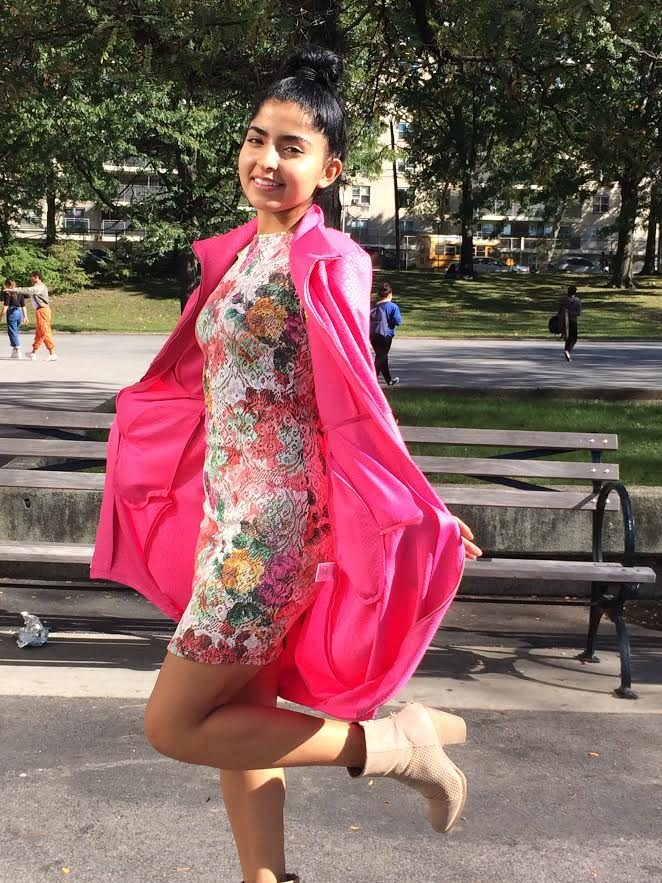 Vivian+Ciddector+%E2%80%9817+exudes+confidence+with+her+outfit+of+vibrant+shades+of+pink+and+floral+patterns.