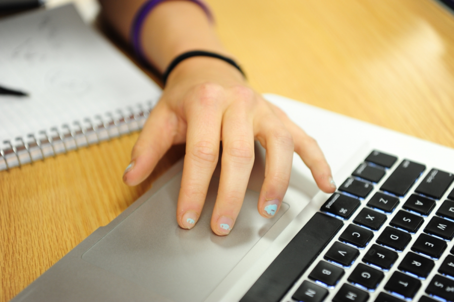 A student uses her laptop in the library.