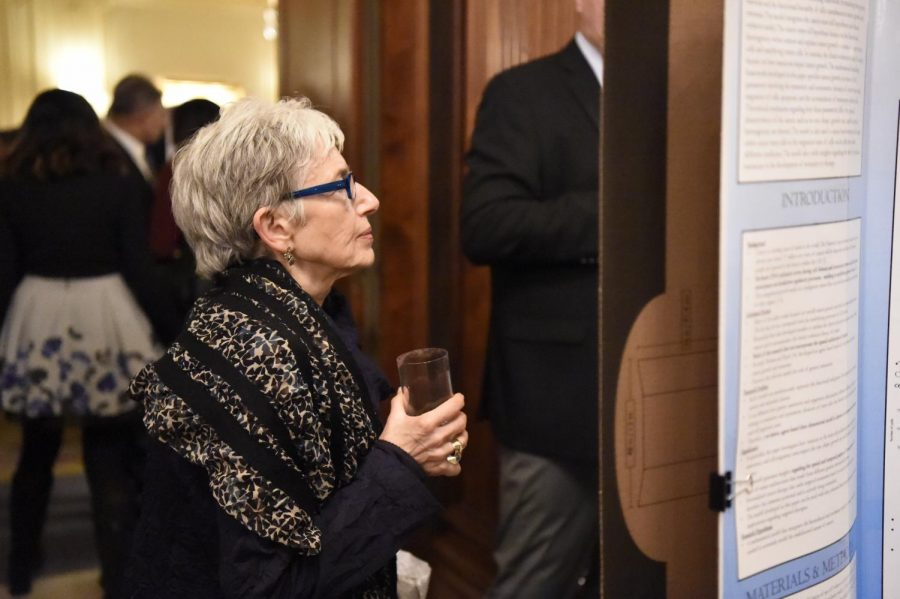 Dava Sobel '64, award-winning science writer, reads a student's Science research project.