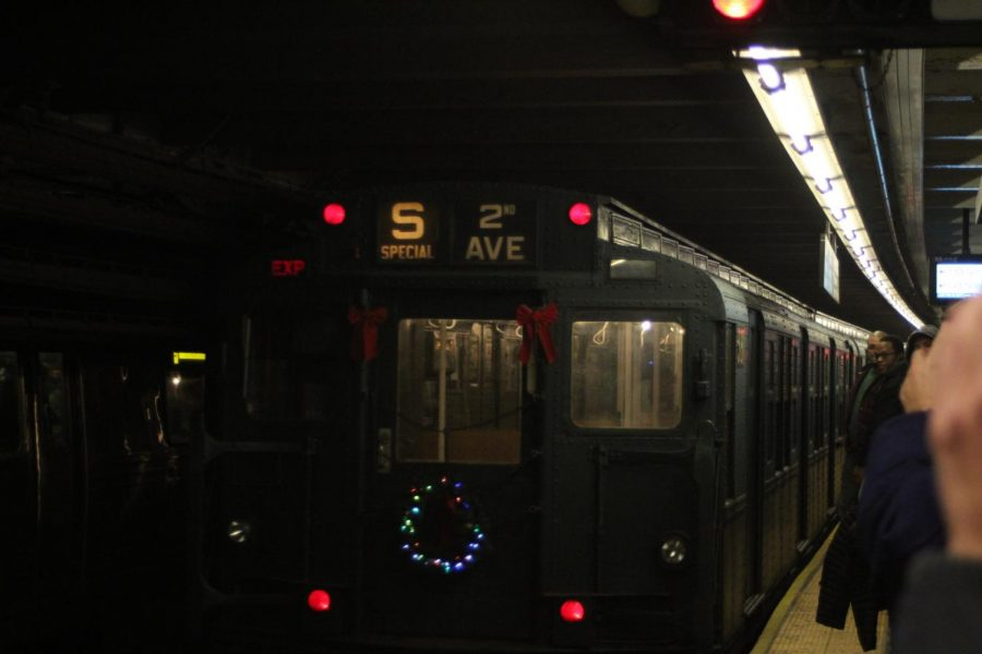 Passengers wait eagerly by the platform as the Holiday Train pulls into the station.