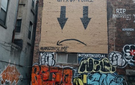 An anti-Amazon mural is painted above an empty lot at 159 Ludlow Street in Manhattan.
