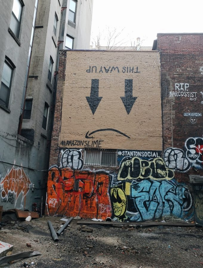 An+anti-Amazon+mural+is+painted+above+an+empty+lot+at+159+Ludlow+Street+in+Manhattan.