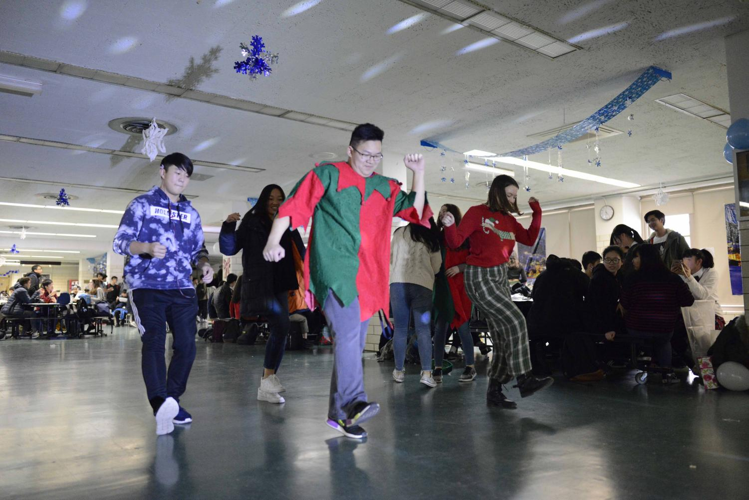 Students get on the dance floor and perform a dance routine during the Winter Wonderland festivities.