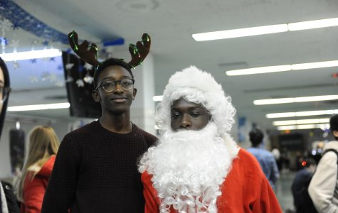 Li Chai Epperson '19 and Babou Gaye '20 dressed festively for the Winter Wonderland.