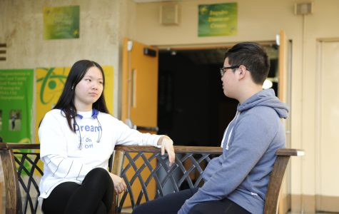 Students Linda Chen '21 and Tommy Ho '21 exchange their opinions on the topic of privatizing social services, such as fire fighting services.