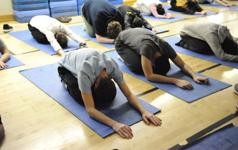 Students perform the Child's Pose or Balasana, a pose that's great for stretching the back, opening up the hips, and relaxing the mind.