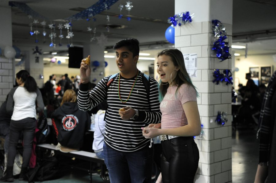 Juniors Anuj Phophaliya and Alea Strasser playing one of the many activities hosted in the Winter Wonderland.