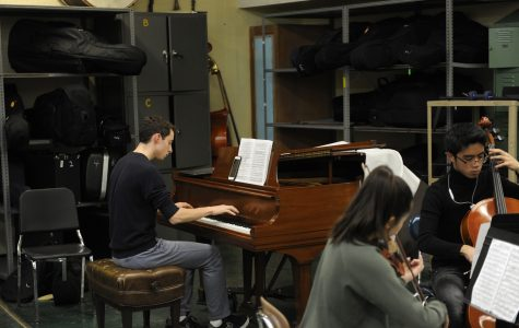 Blake Frank '20, the pianist, practicing his part for the piece.