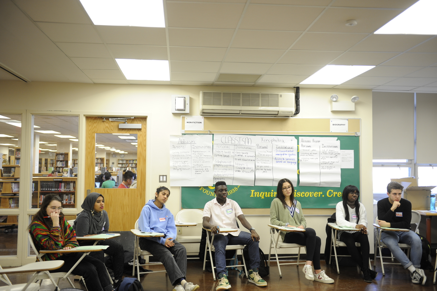 Students reconvene to share what they spoke about in small groups during an ADL meeting.