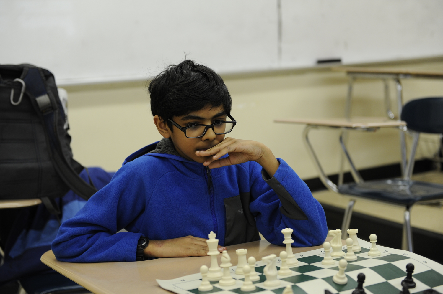 Chess Club member Zayedali Shaikh '22, decides upon his next move.