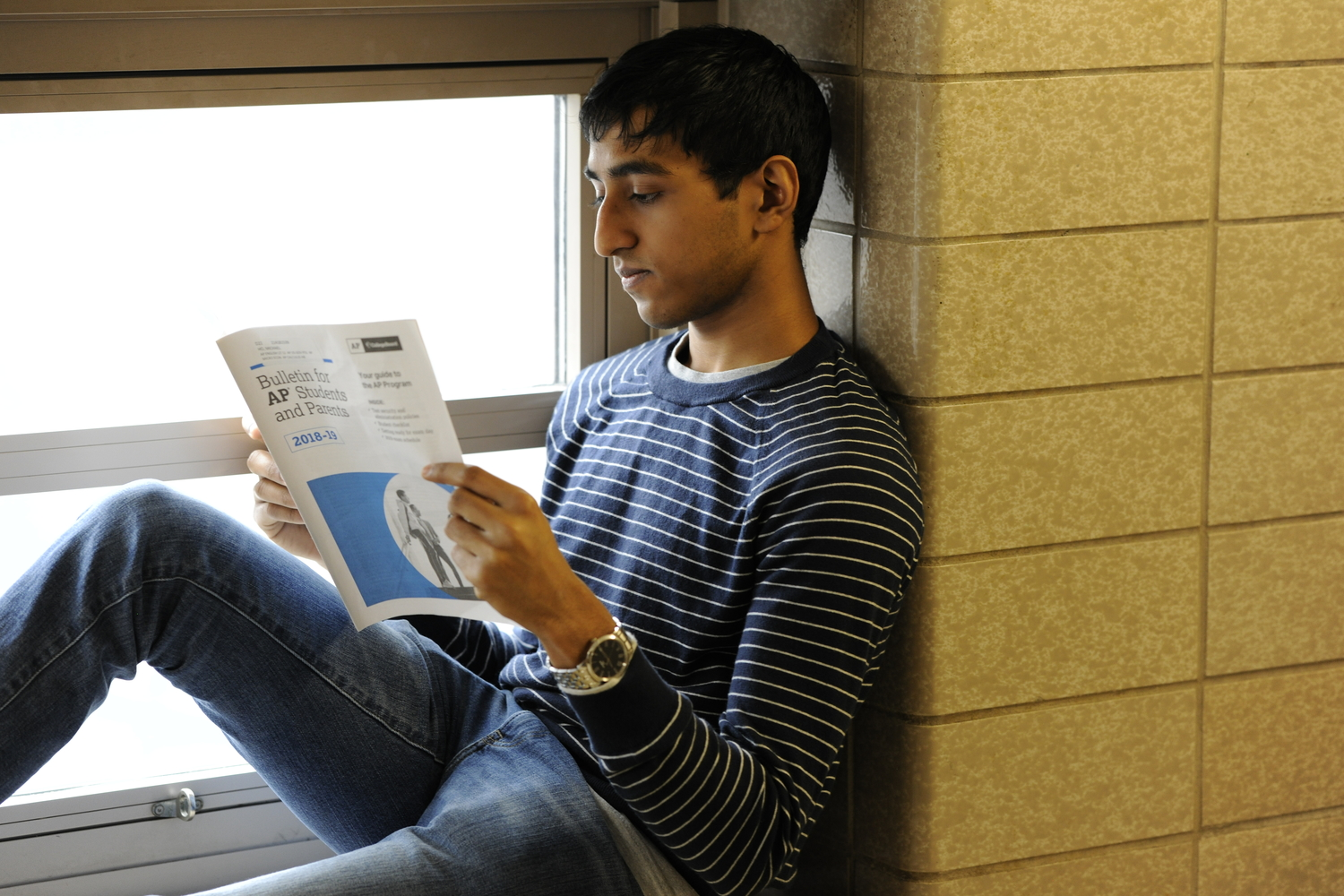 Tejpal (Phillip) Ramdas '19 reads the Advanced Placement Bulletin packet for more information on the upcoming A.P. exams.