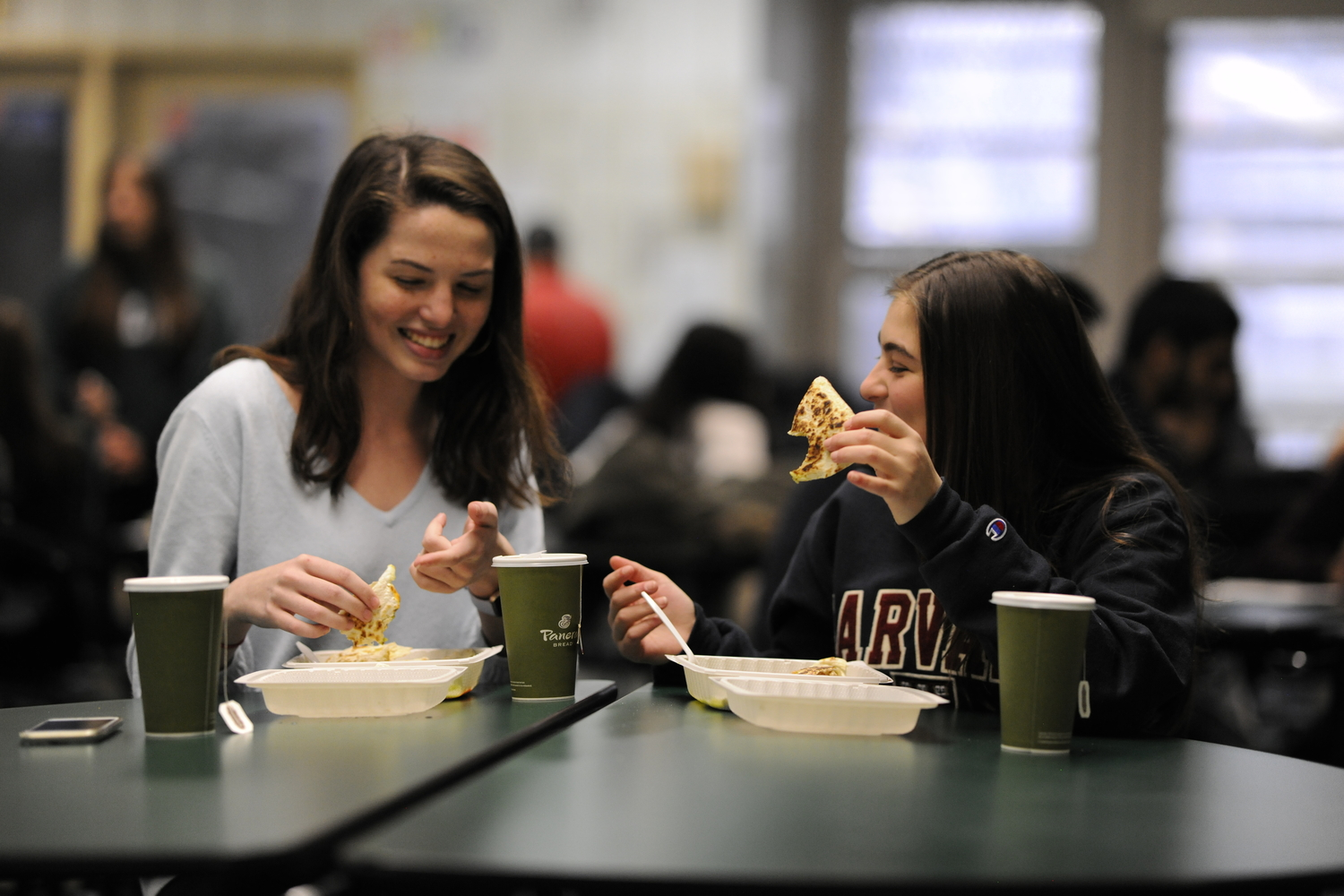 Mary Tyrrell '19 and Helena Macrigiane '19 enjoy their lunch using one of the alternatives to foam containers.