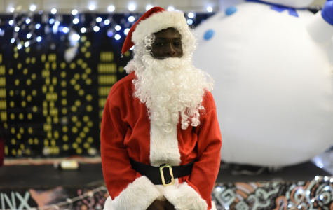 Baboucarr Gaye '20 dresses as Santa Claus for the Winter Wonderland.